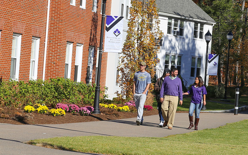 People walking on Curry College academic quad
