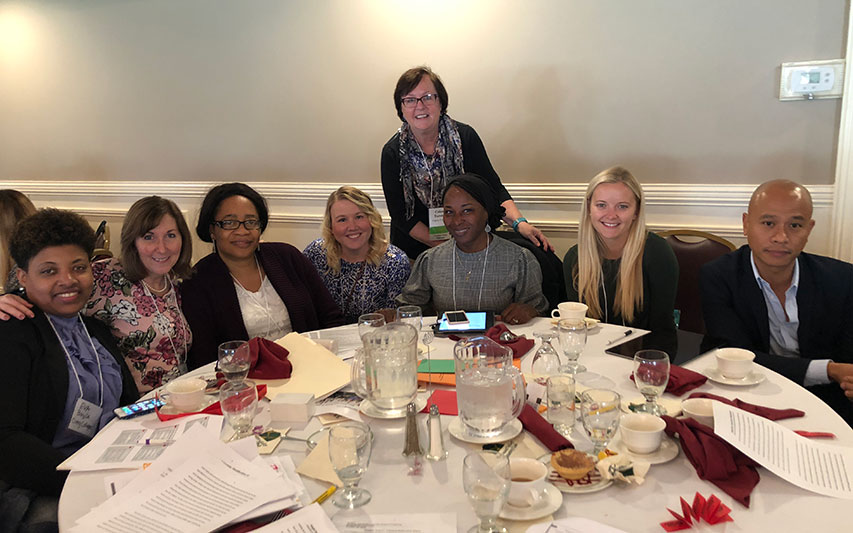 (L to R) Eva Bazile, Katherine O'Connor, Grace Mbawuke, Amy Lanigan, DeElla Johnson, (Dr Coleen Toronto in back), Kristyn Calla, and Noel Aguilar
