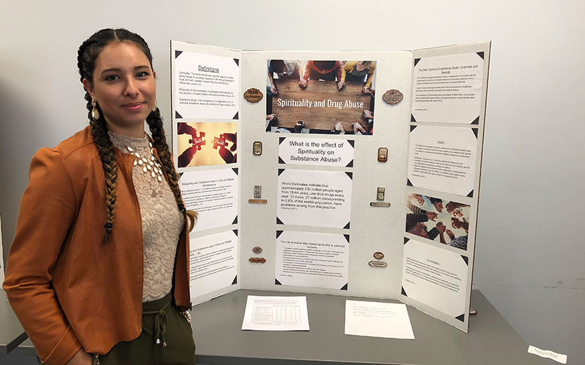 Jochebed Amaral, Class of 2018, presents research at the Summit for Opiate Solutions hosted by Psychology faculty members.