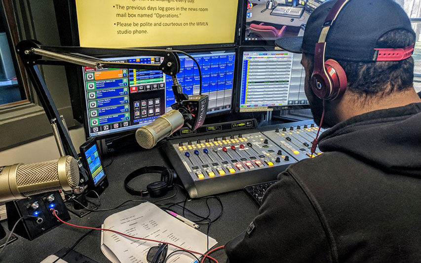Communication student Garrett Riley, Class of 2018, broadcasts to listeners over a 40-mile radius as a WMLN-FM DJ.