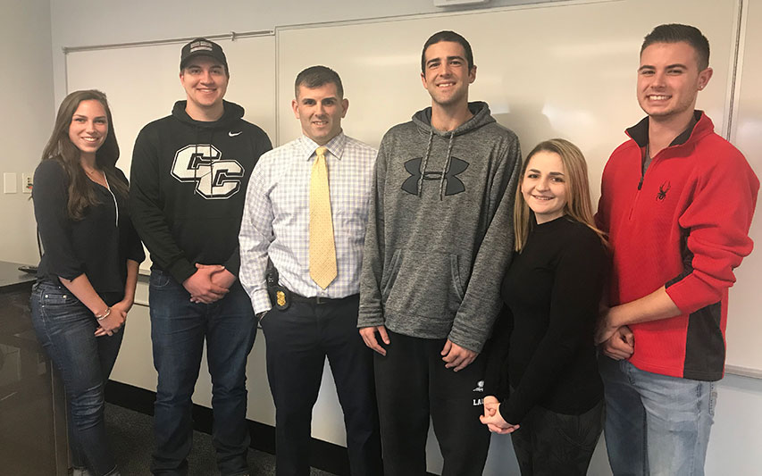 Special Agent Philip Belmont '04 with Criminal Justice students