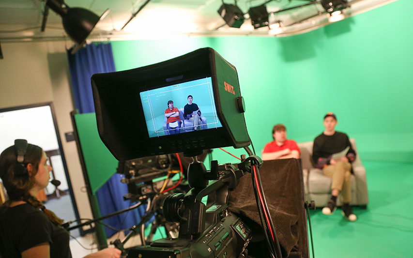 Curry College Communication Students filming a CC8 production