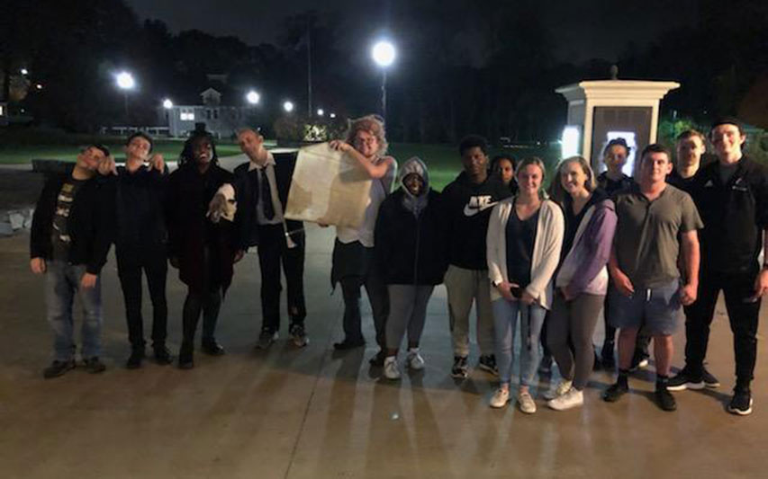 "On Halloween night, students were took part in a game that forced them to match their skills and wits to stay ""alive."" The game was led by Dr. Rob Smid's ""The 'Walking Dead' as an Introduction to Philosophy"" class."