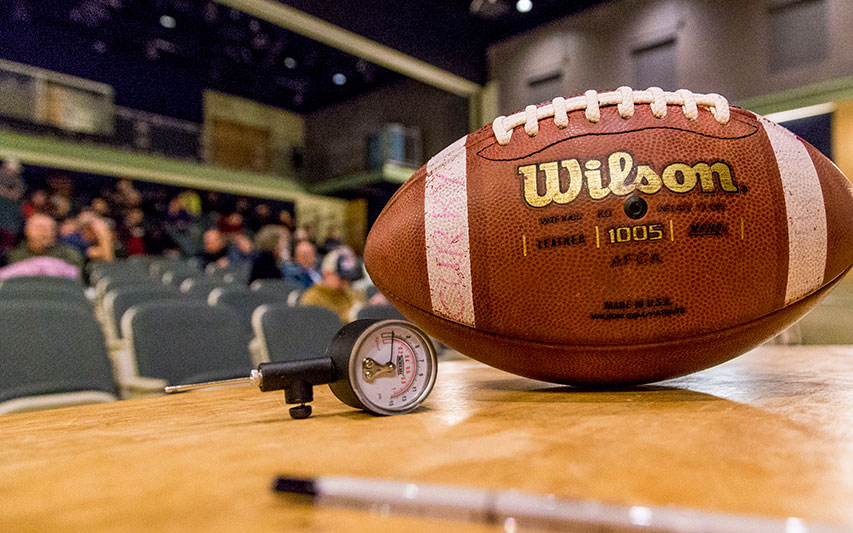 A football sits in the foreground as Students, Faculty Explore the Intersection of Science, Law, and Media with Deflategate Documentary Filmmakers