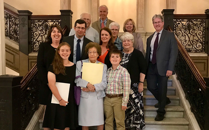 Politics and History Professor Hazel Varella celebrates with friends, colleagues, and family members at the State House.