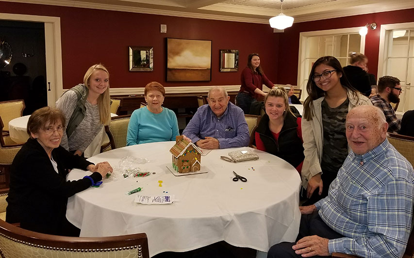School of Nursung student make gingerbread houses with senior residents
