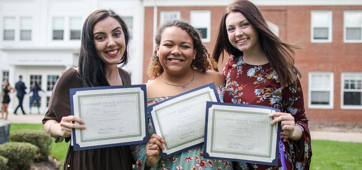 Curry College students receive their Alexander Graham Bell Honor Society membership certificates