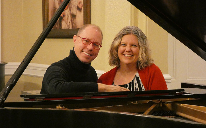 Pianist Dr. Matthew Larson and vocalist Beth Canterbury sit at a piano