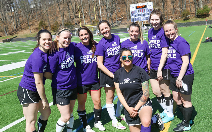 Curry Colonels Women's Soccer Alumni pose in matching t-shirts