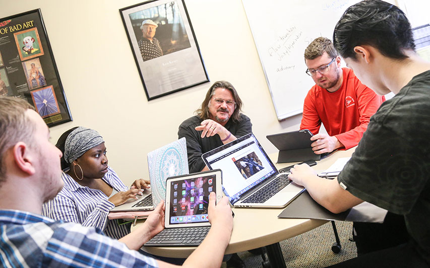 PAL students and professors collaborate in the classroom