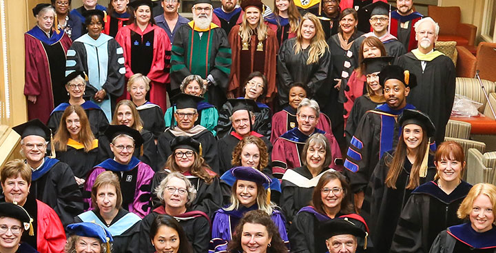 Curry College employs about 500 full- and part-time faculty and 81% hold a Ph.D or terminal degree in their field; faculty pictured here are convened for the annual academic convocation.