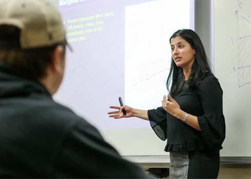 Dr. Ishani Tewari teaches a class at Curry College