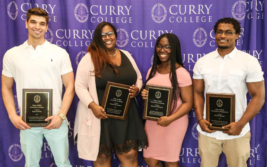 Curry College students pose with their awards at the Awards Ceremony.