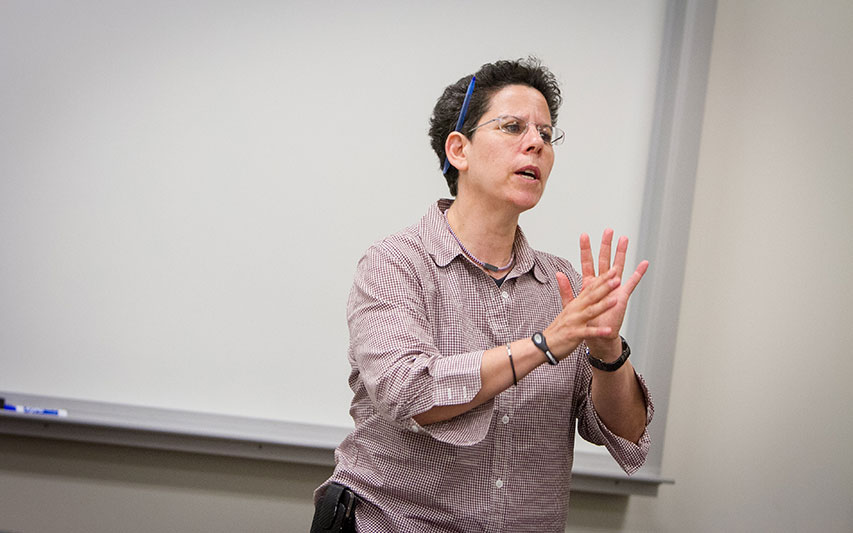 Dr. Karen Lischinsky, professor of Criminal Justice and Sociology, delivers a lecture to Curry College students.