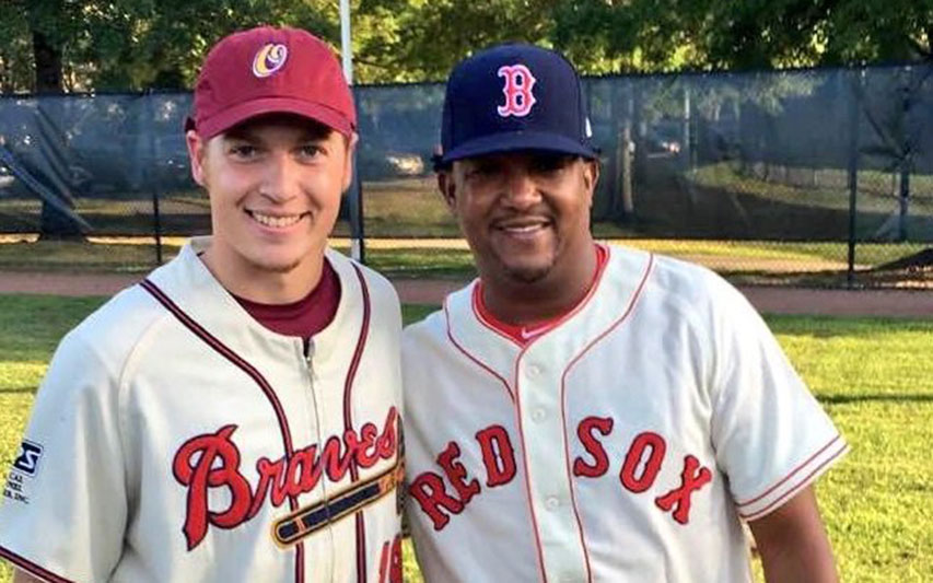 David Griffin, Class of 2018, with Pedro Martinez on baseball field