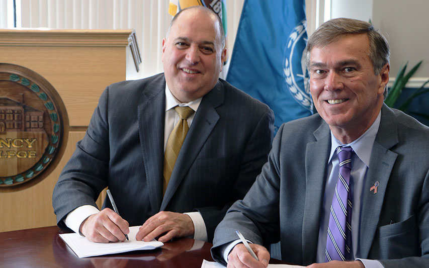 Quincy College President Michael G. Bellotti and Curry College President Kenneth K. Quigley, Jr.