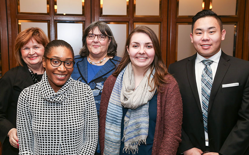 Trustee Joyce A. Murphy, Hon. '99, MPA and Katherine Hesse, Esq., pose with students at Women's Leadership Council event.