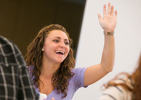 A student raises her hand in class