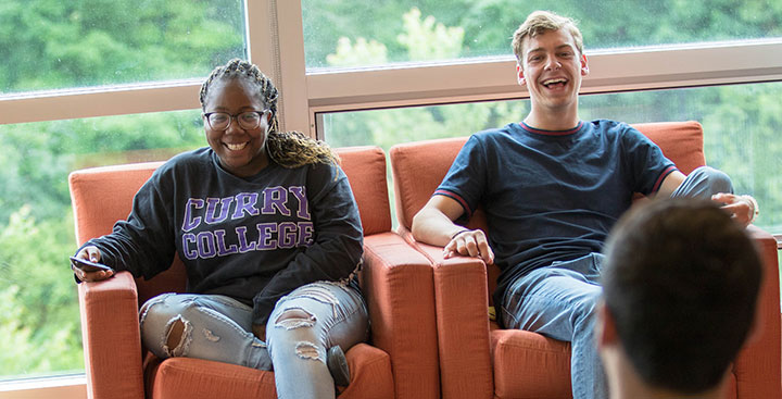 Curry College students hangout and laugh in the residence halls