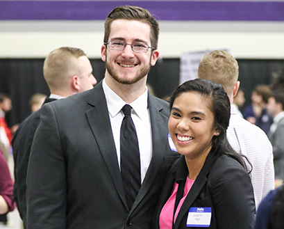 Students smile and pose for a photo at the Career and Internship Fair
