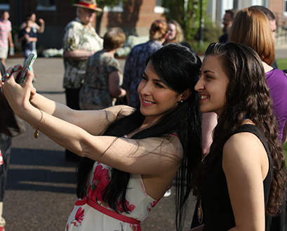 Students take a selfie on campus