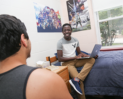 Students hang out in a residence hall room