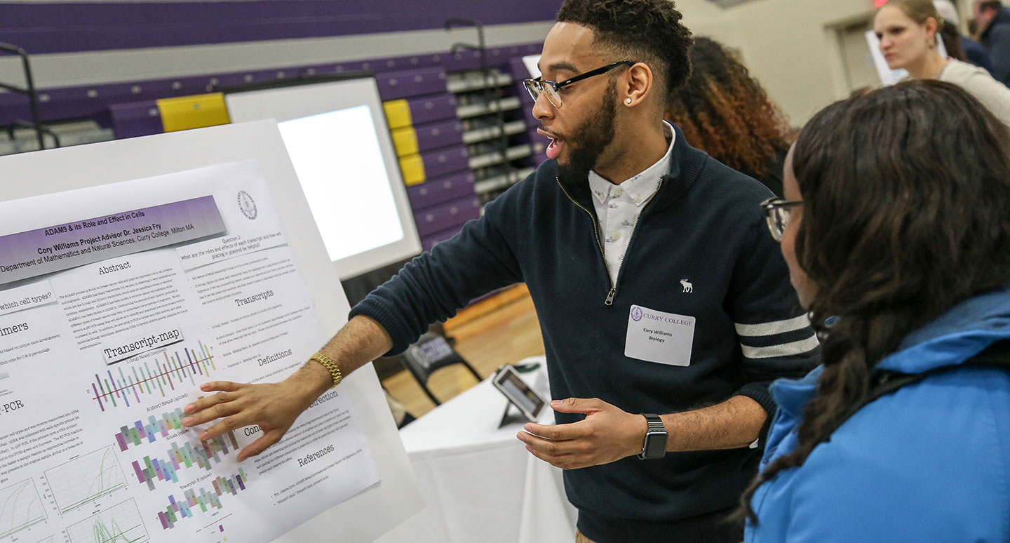 A student presents his research at the Curry College Annual Academic Forum