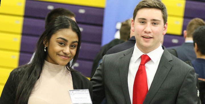 Recent Curry College graduates dressed for success and recruitment