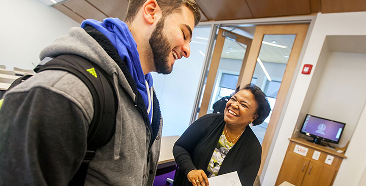 Curry College student and faculty interact in class