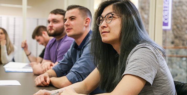 A Curry College student listens to a Center for Career Development presentation