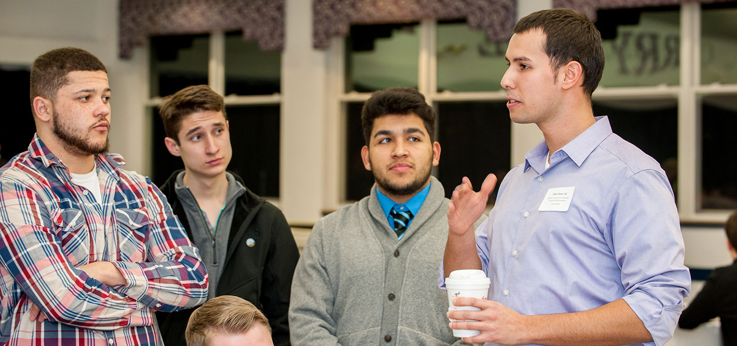 A Curry College alumnus gives career advice to students as part of a Center for Career Development Networking event