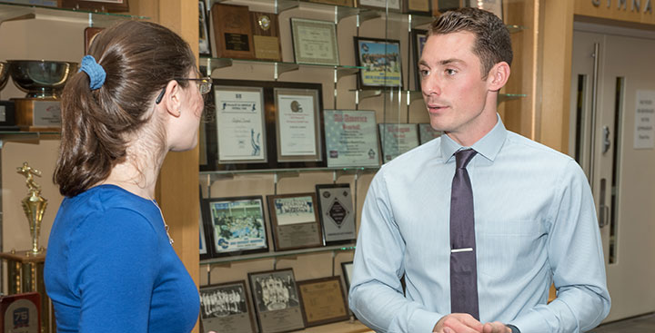 A Curry College alumnus gives career advice to a student as part of a Center for Career Development Networking event
