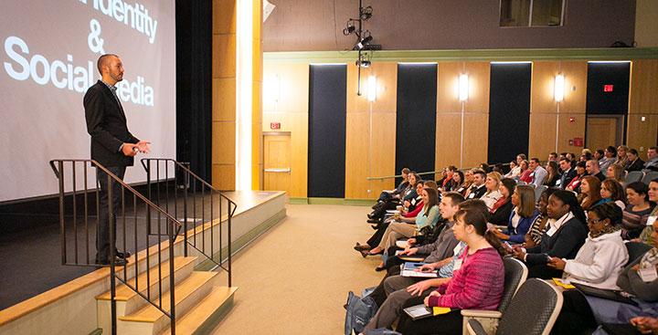 The keynote speaker presents at the Curry College Center for Career Development Senior Conference event
