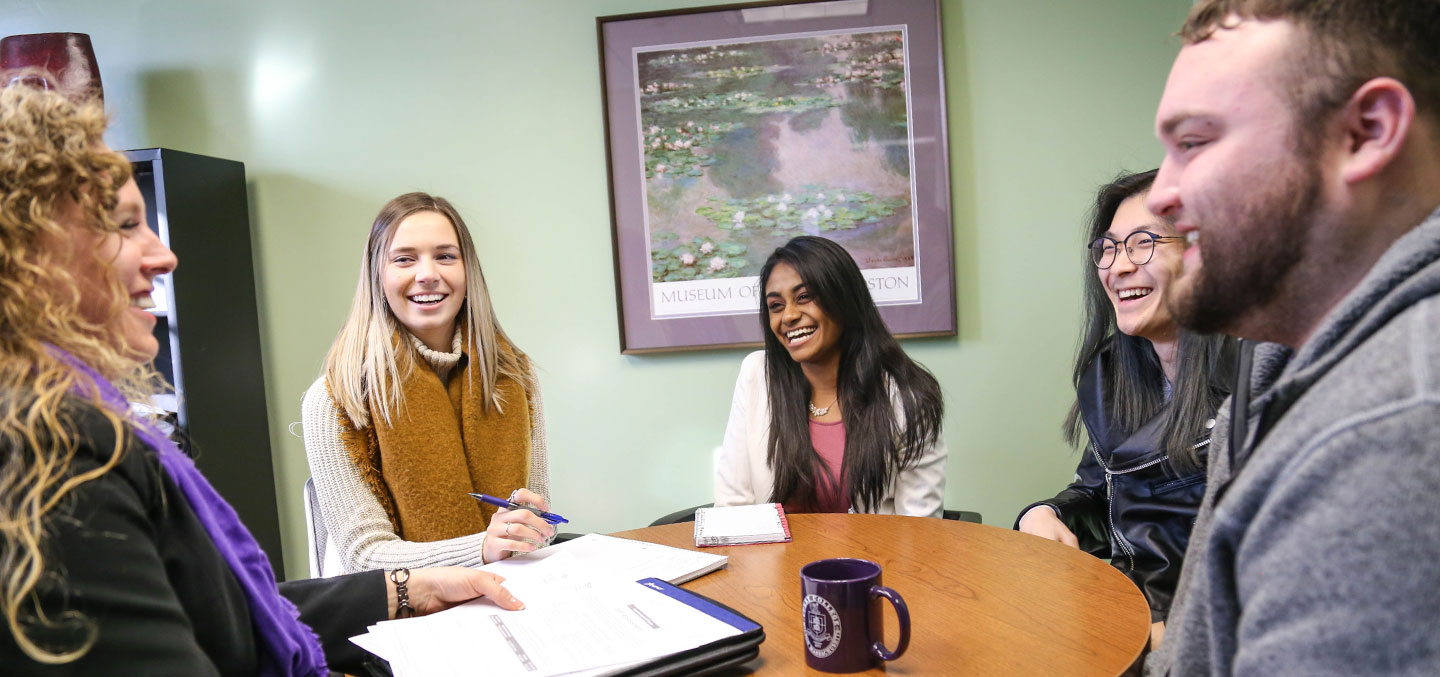 A Curry College Center for Career Development staff member provides students the service of a career advice group session