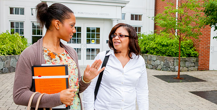 Students in a Curry College Continuing Education program walk on campus