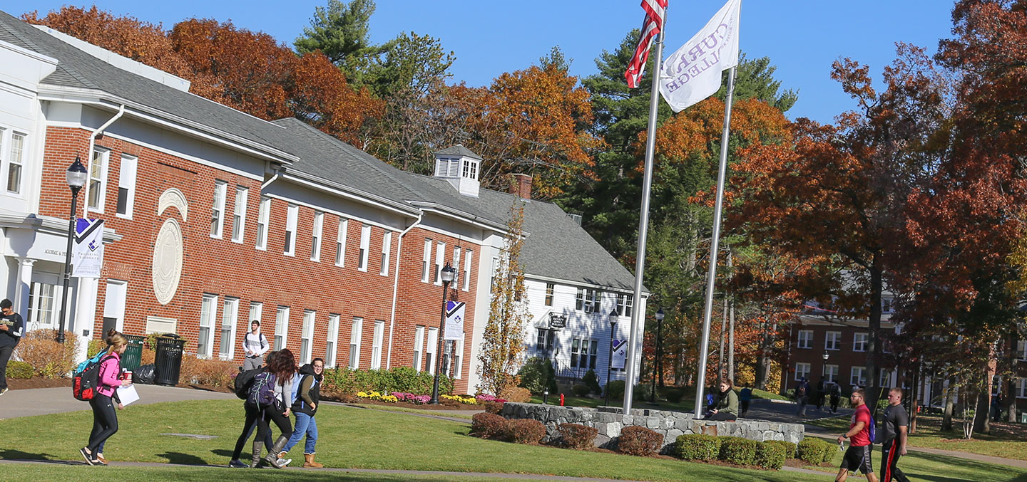Scenic of the Curry College Milton Campus Quad with students walking to class