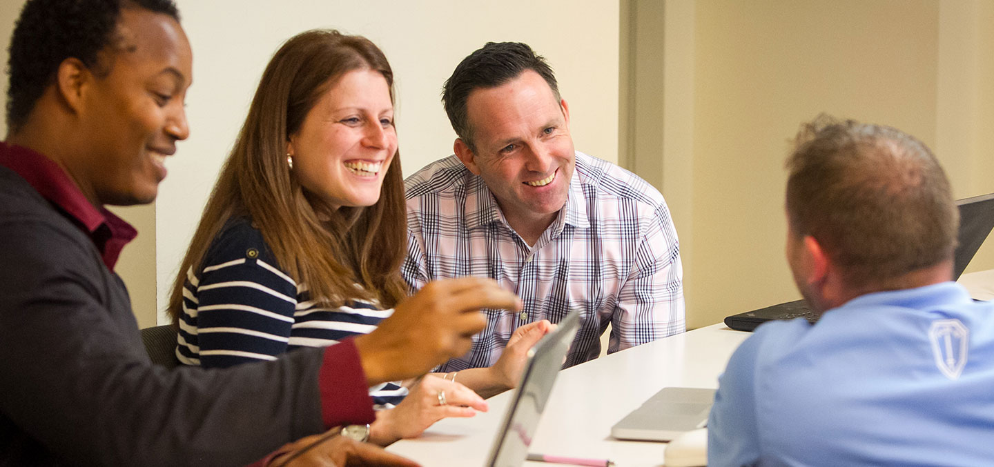 Curry Colege students pursuing a Graduate Studies Degree in class collaborating on a project