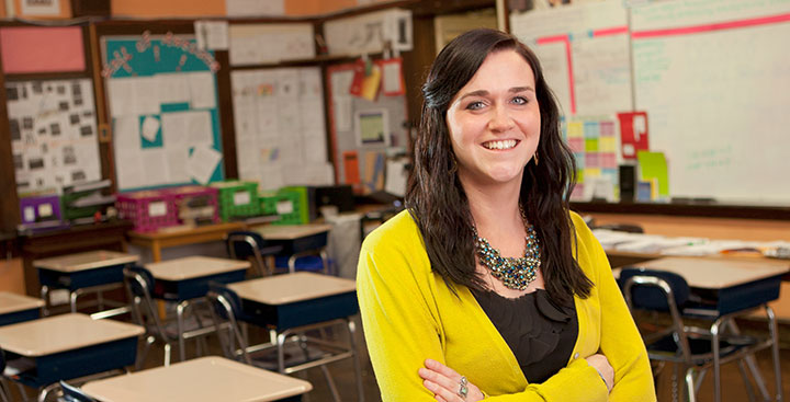 A Curry College Master of Education (M.Ed.) alumna pays stands proud in her very own classroom