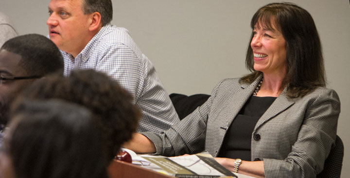A Curry College Master of Science in Accounting student smiles in class