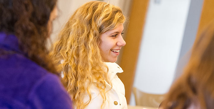A student in the Curry College Honors Program participates in a discussion in class