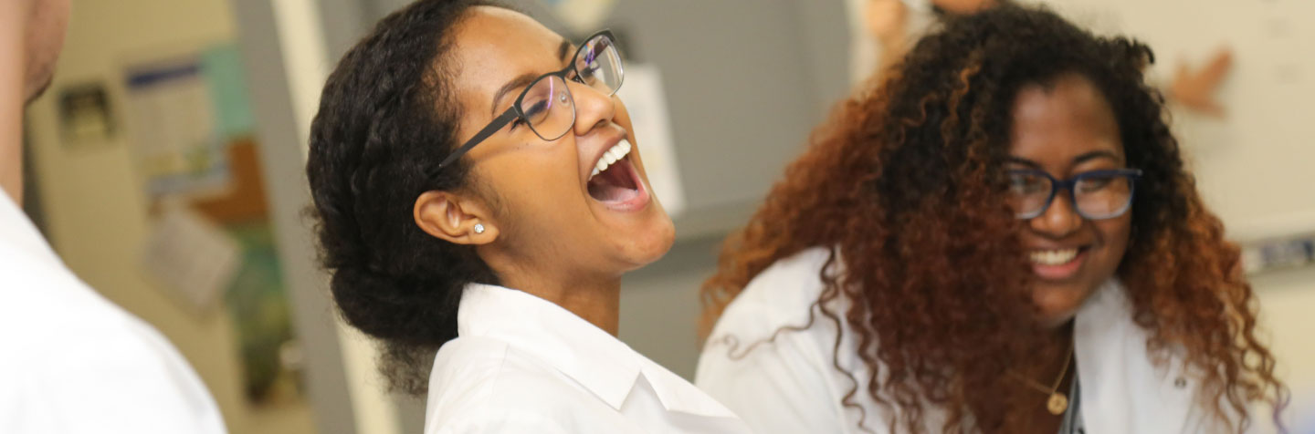 First-Year student enjoy a laugh in the classroom at Curry College