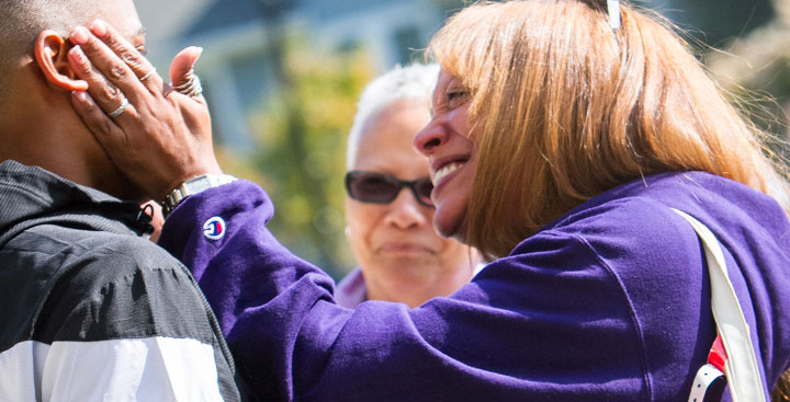 A Curry College First-Year parent hugs her son