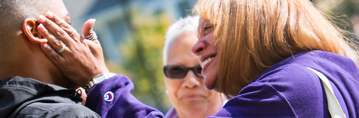 A First-Year parent hugs her son on the first day of Curry College