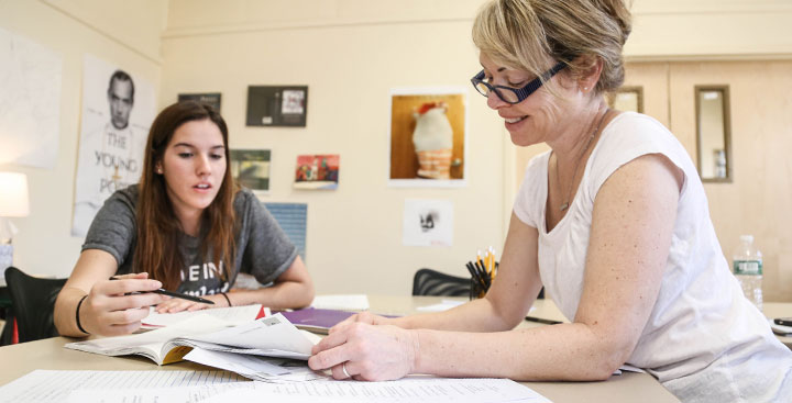A student in the Program for Advancement of Learning (PAL) meets with her professor