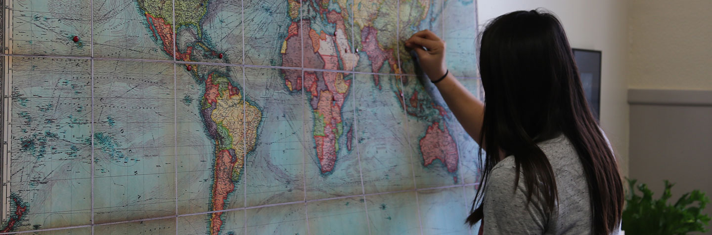 A PAL for Multilingual Student places a pin in a map