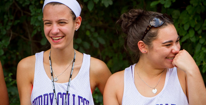 Curry College Summer PAL students laugh while doing an activity on campus