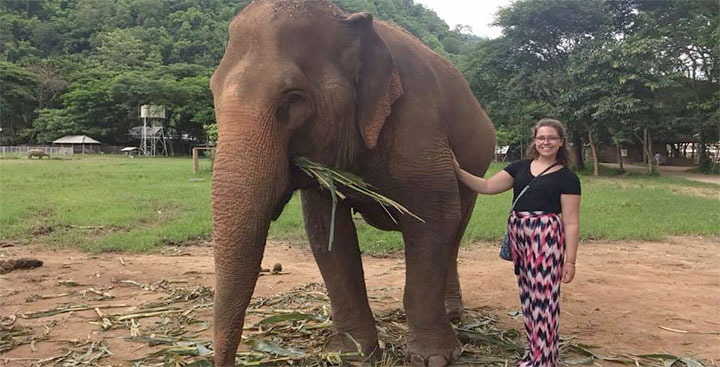 Jackie Cotter '19 poses with an elephant in Chiang Mai, Thailand