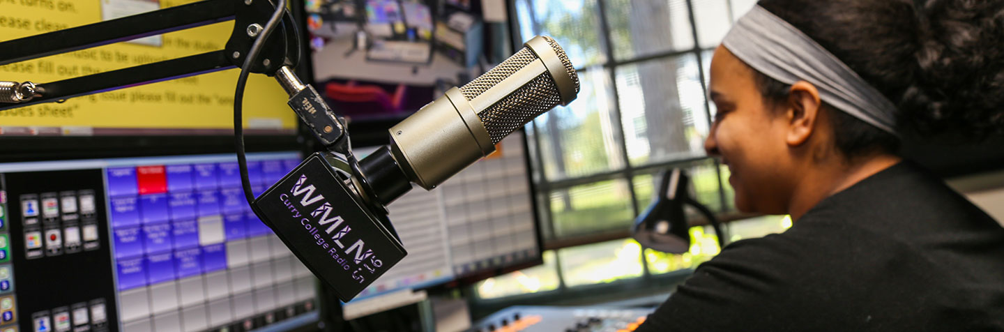 Curry College WMLN student doing her own radio show