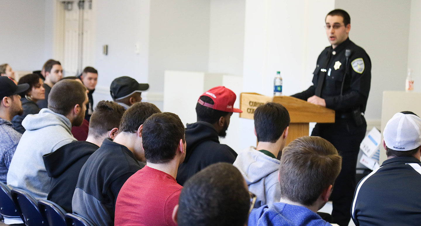 An officer speaks to criminal justice students