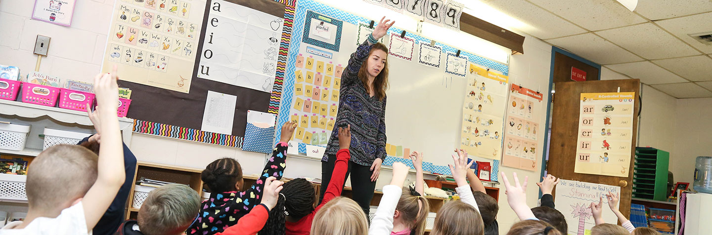 Curry College Education Degree alumna teaching in a local school classroom